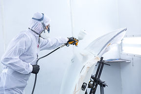 automobile repairman painter in protecti