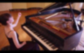 Mary at piano.png