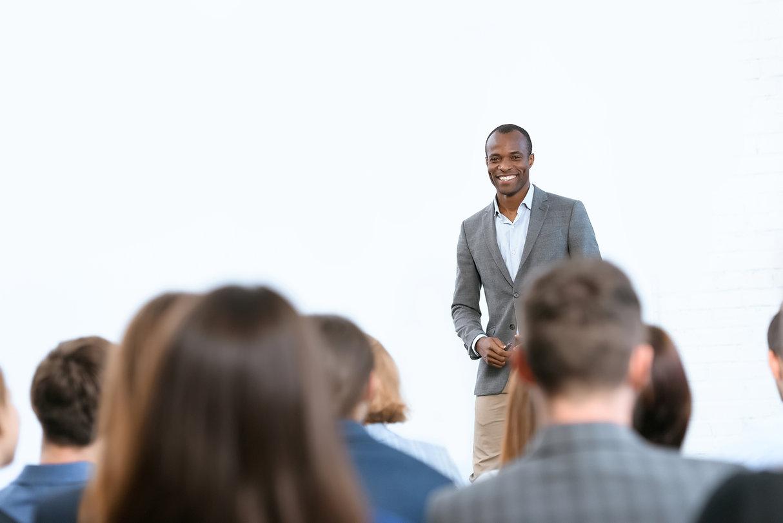 Black man leading a meeting