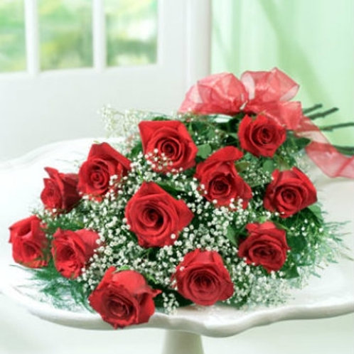 Dozen red roses wrapped in tissue