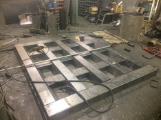 Heavy duty tailgate being fabricated for a slate hauler in West Va