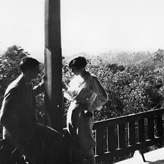 A young couple enjoys the beautiful view on the porch of the Montvale Hotel int the 1800s.
