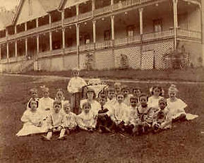 A group of children gather outside the Montvale Hotel in the 1800s