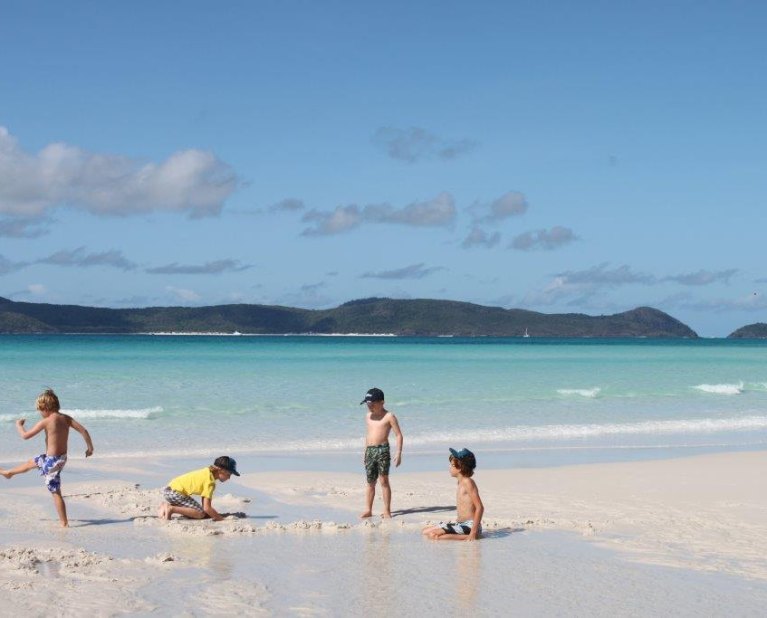 Playing on deserted Whitsunday beach