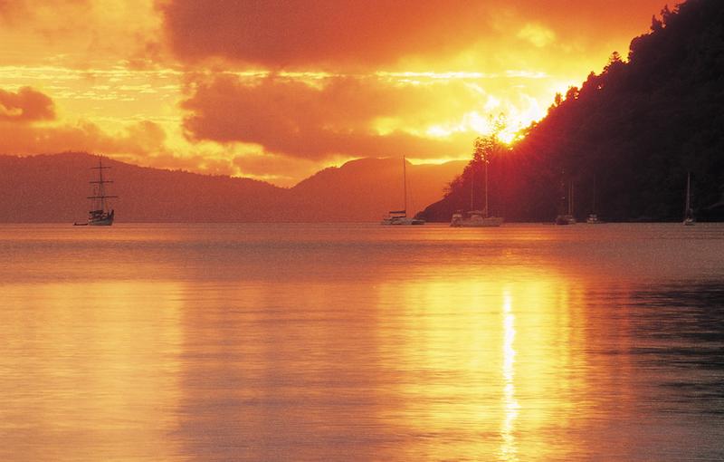 Whitsunday island sunset boats