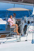 go bareboating. you don't need a licence to drive a bareboat in the whitsundays