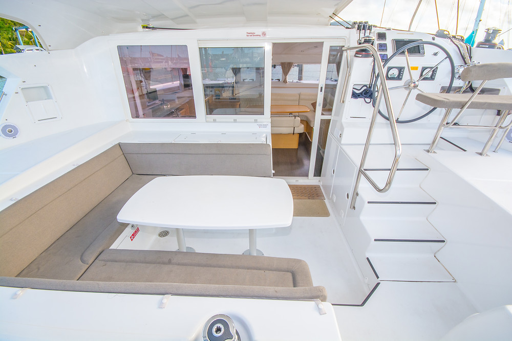 the cockpit of a luxury sailing catamaran you can hire as a bareboat in the Whitsundays