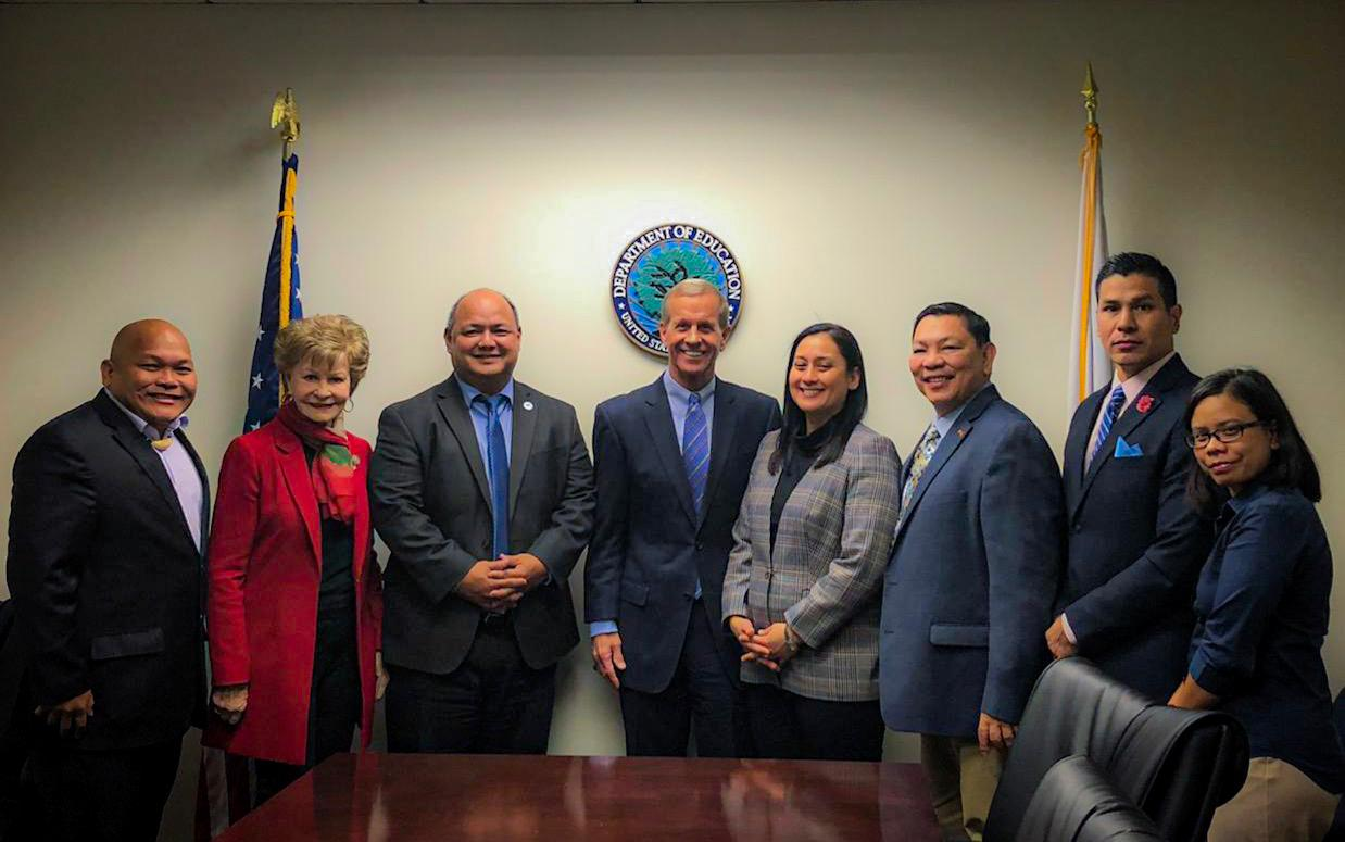 Vice Speaker Telena Cruz Nelson poses with Frank Brogan, Assistant Secretary for Elementary and Secondary Education, fourth from left, Washington D.C. liaison and former Congresswoman Madeleine Bordallo, Guam Education Board Chairman Mark Mendiola, Guam Department of Education Superintendent Jon Fernandez and other GDOE representatives after a November meeting to discuss the lifting of GDOE's high-risk designation in Washington D.C..