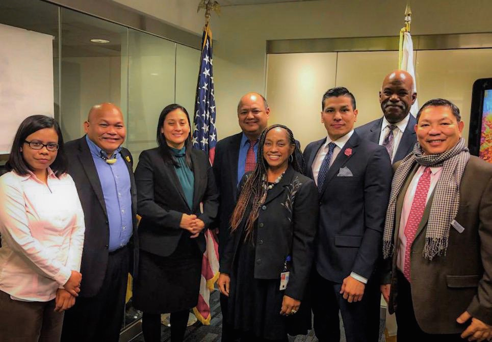 Vice Speaker Telena Cruz Nelson poses with U.S. Department of Education senior risk consultants Christine Jackson, fifth from left, Mark Robinson, seventh from left, and Guam Department of Education representatives after a November meeting to discuss the lifting of GDOE's high-risk designation in Washington D.C.