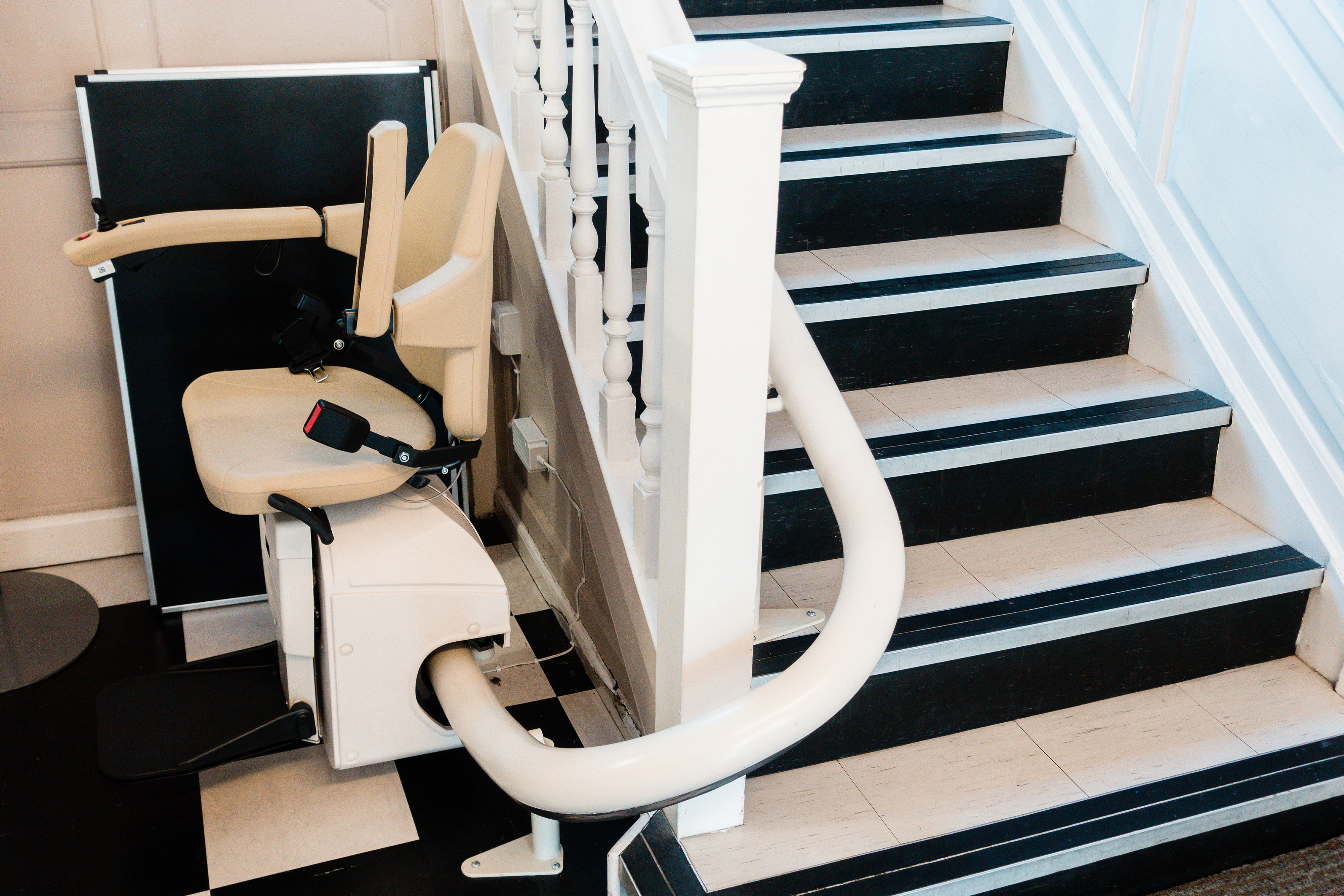 White stairlift on staircase for disable