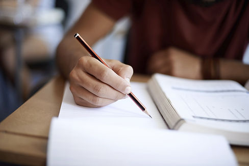 A student writing notes during a course