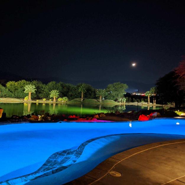 POOL AND LAKE AT NIGHT