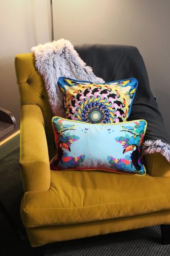 Jungle cushions on yellow chair