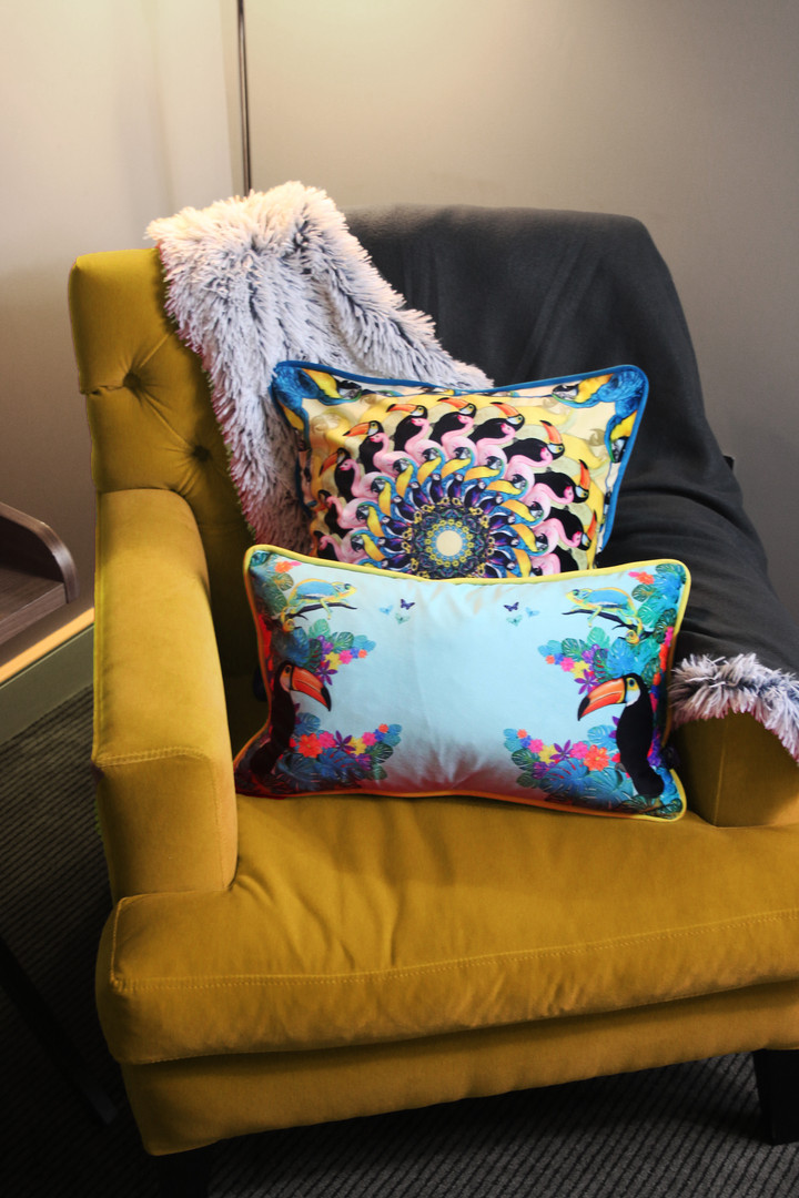 Jungle cushions on yellow chair