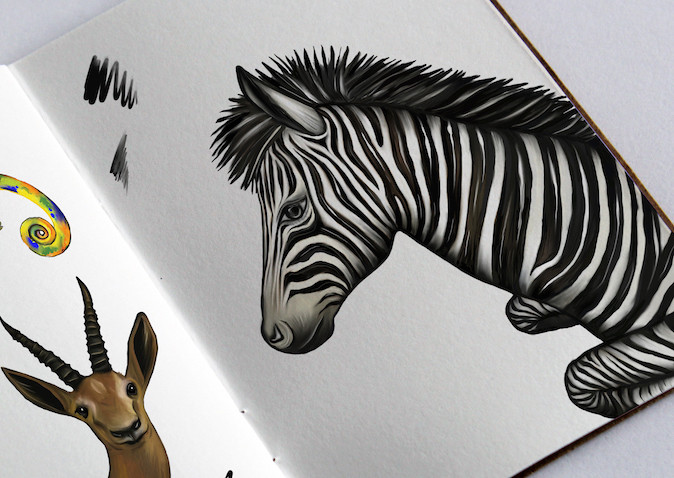 Sketchbook with zebra and gazelle