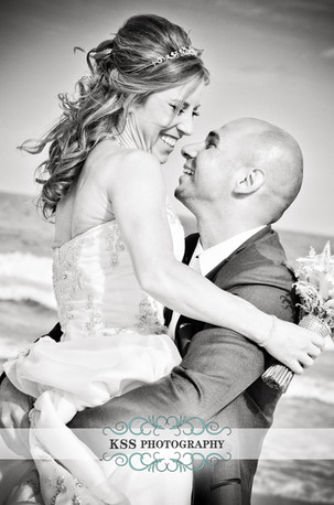 bride-and-groo-embrace-on-jersey-shore-long-beach-island-wedding-new-jersey