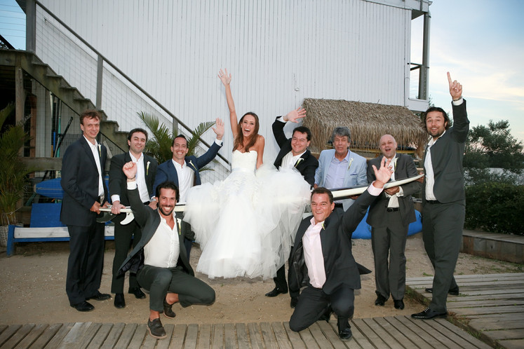 bride-fernanda-monfrinatti-on -surf-board-in-montauk-surf-lofge-wedding-hamptons