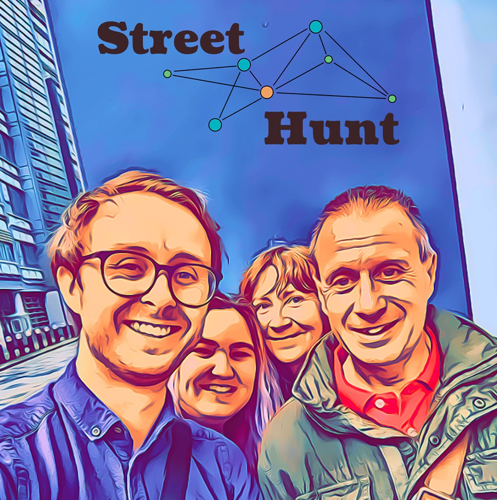 """Two men and two women smiling, in an arty comic book like-filter. """"Street Hunt"""" is written at the top"""