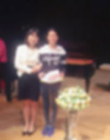 Rebekah with her student at the piano concert in 2018.