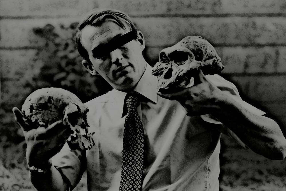 Man holding skulls