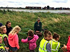Little Bears Forest Preschool - Milton Locks - children listening to Jess Daish Miller, Hants & IoW Wildlife Trust