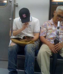 Korean Guy Wearing Baseball Cap on Train