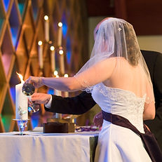 Lighting Unity Candle at Wedding