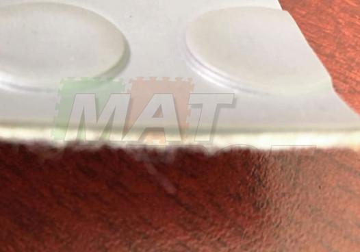 Detalle Tapete de PVC de círculos base textil