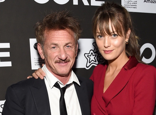 Sean Penn and his 27 year old girlfriend. Rare sighting.