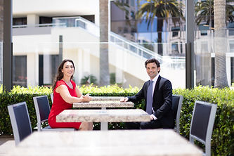 Jennifer Grady and Anthony Mance sitting in MacArthur Court outdoor table