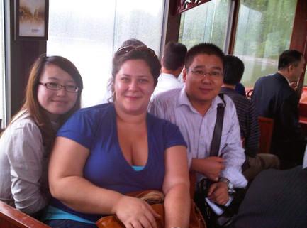 Liv, Sarah & Mr. Wang, on the boat.jpg