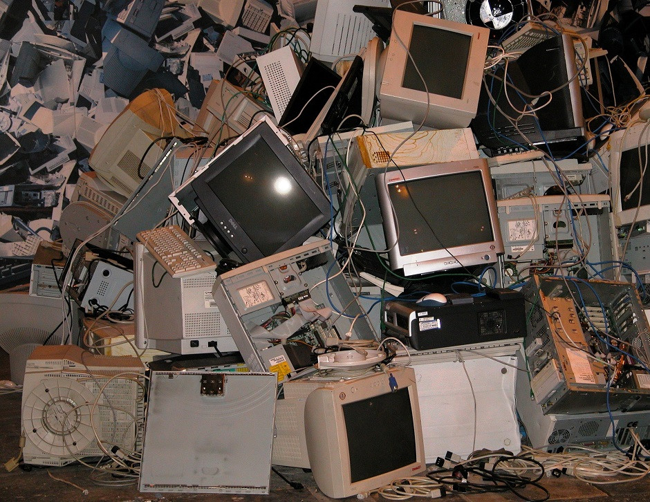 high pile of old computers, monitors and other electronic waste