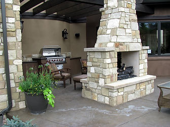 Conroe custom outdoor kitchen with fireplace
