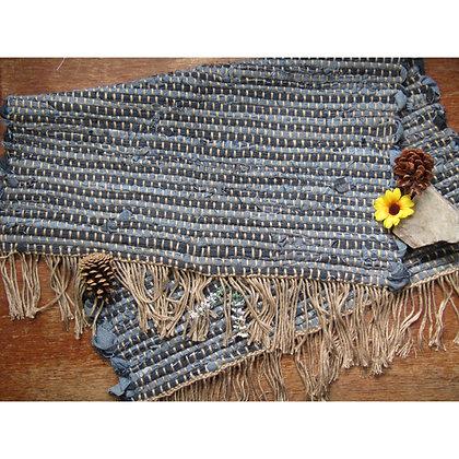 Staged Dark Blue Woven Rug