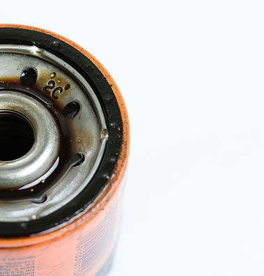used automotive oil filter with oil stai
