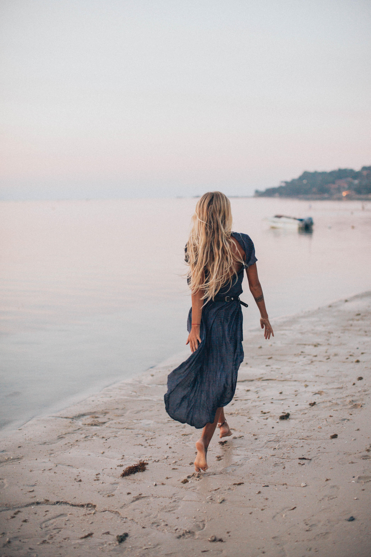 photo-of-woman-walking-on-seashore-20725