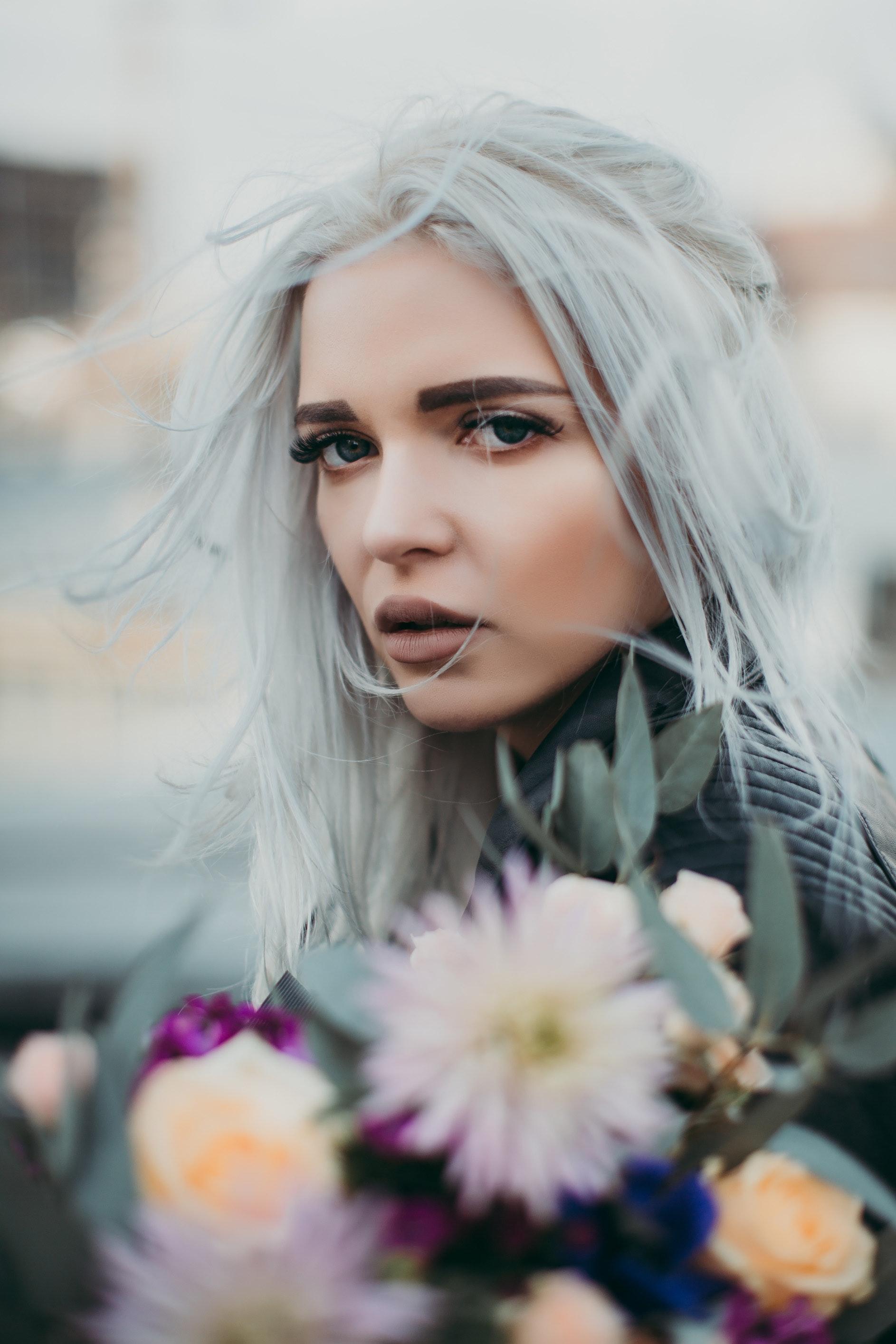 woman-carrying-flowers-closeup-photo-103