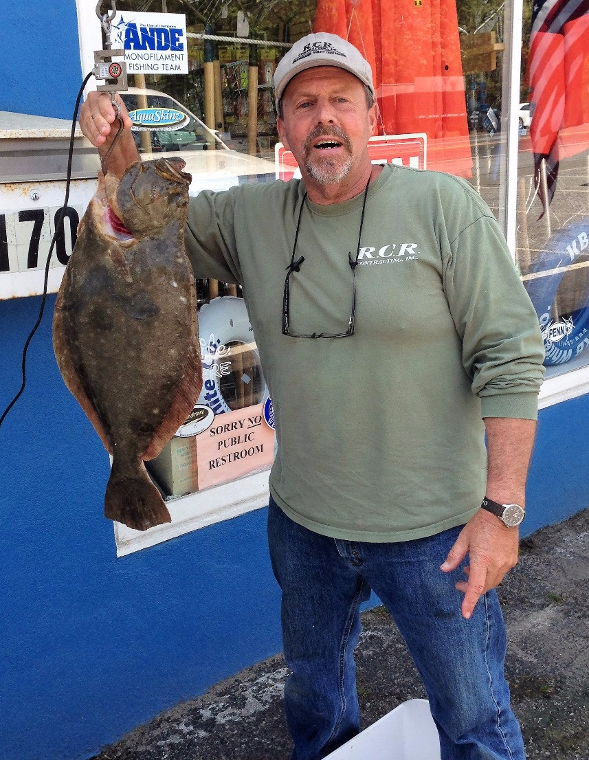 Rick Rattler with a 7.5 # Fluke from the East Cut on Wednesday.