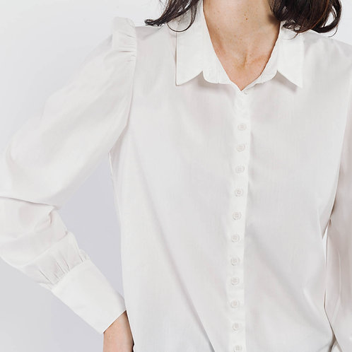 חולצה לבנה מחוייטת, צווארון, שרוולים נפוחים באיזור הכתפיים, כפתורים