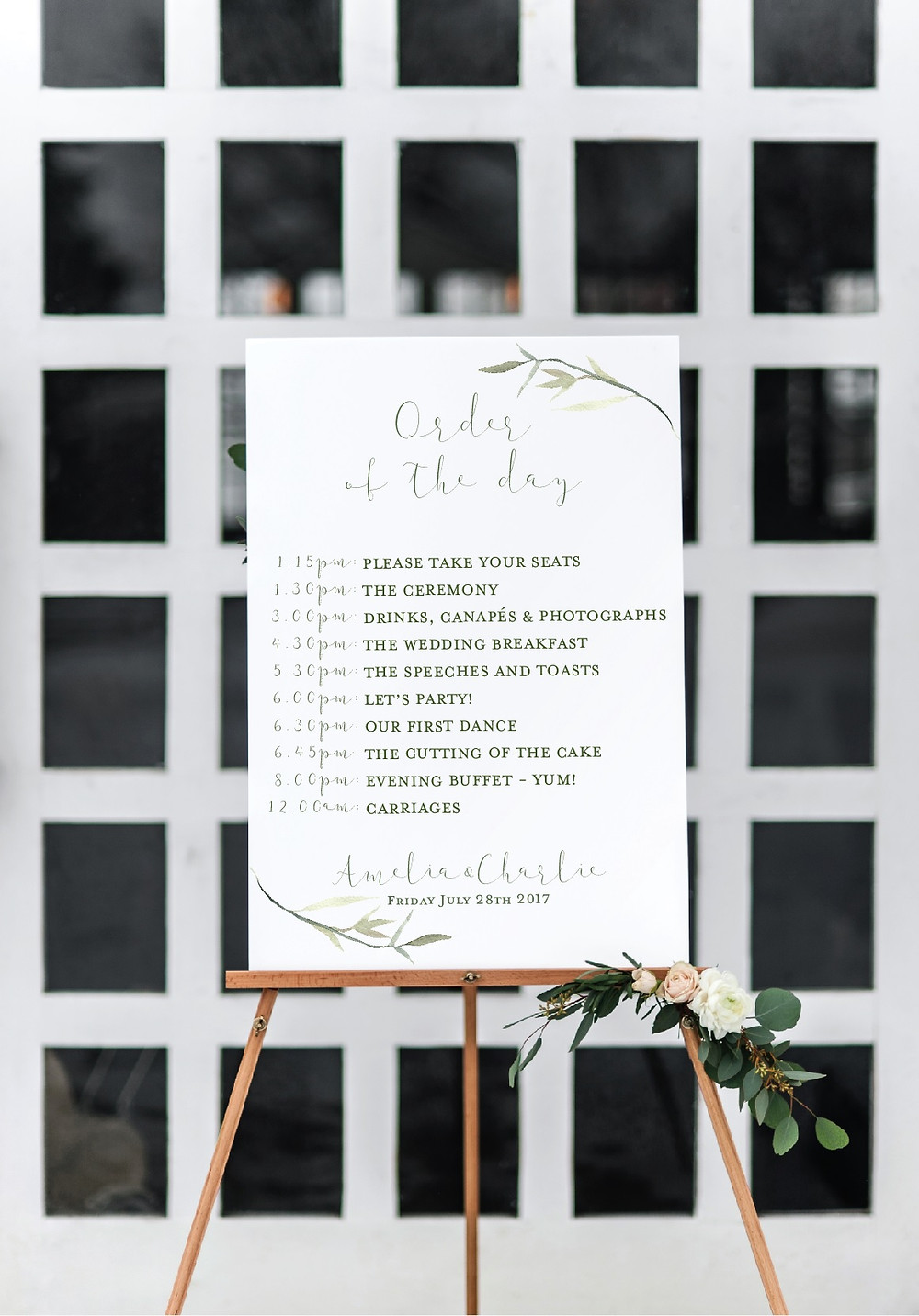 Elegant greenery wedding sign order of the day