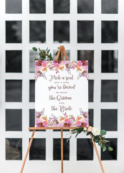 floral pick a seat wedding sign