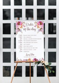 Rustic floral wedding timeline sign