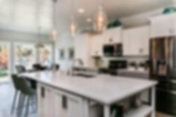kitchen remodel design custom white shaker cabines quartz countertop glass tile backsplash open concept kitchen home remodel renovation