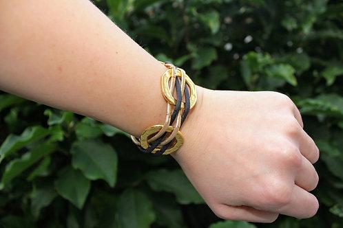 Bracelet Black and Gold rings