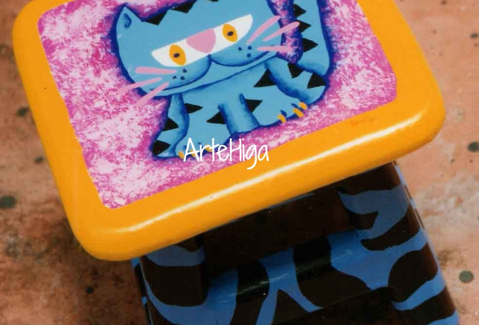"""A Blue Tiger"" on a stool"