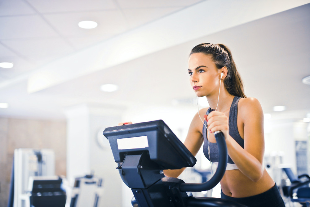 exercising on treadmill with earphones