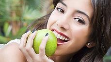 Dentist in Warren, NJ, girl biting apple, girl smiling,