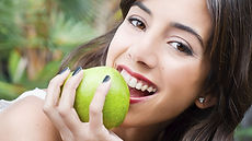Dentist in Warren, NJ, girl biting apple, girl smiling,