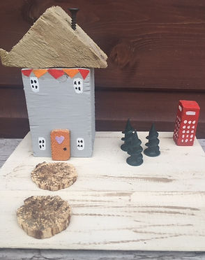 rustic cottage. wooden houses. upcycle shabby chic, old phone box, bunting, pine trees