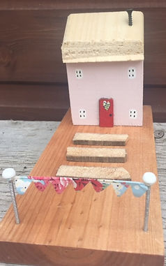 rustic cottage. bunting. pastel pink. wooden houses. upcycle shabby chic